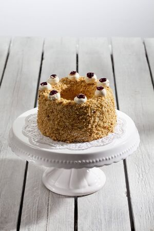 cakestand: Frankfurt crown cake with crocant on cake stand Stock Photo