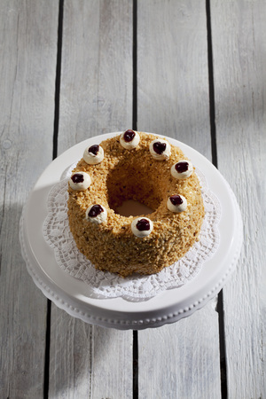 cake stand: Frankfurt crown cake with crocant on cake stand Stock Photo