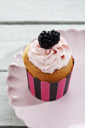 frill: Cupcake, blackberry, paper frill on plate