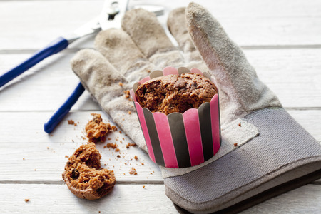 work glove: Break, work glove, cupcake and gaspipe pliers on wood