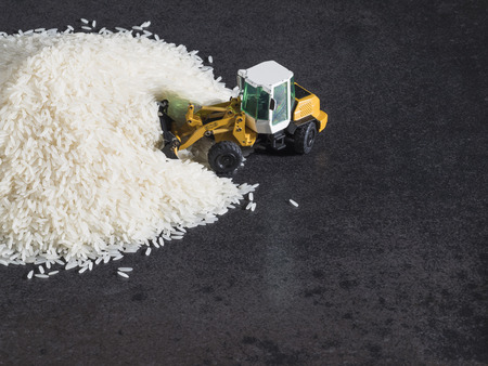digger: Toy digger on pile of rice, staple, distribution, trade