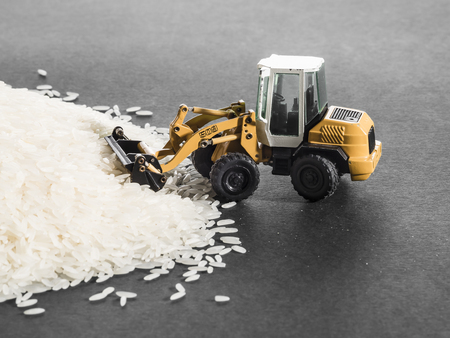 staple: Toy digger on pile of rice, staple, distribution, trade