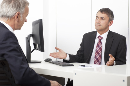 Office worker, consultant, in office with client