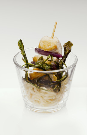 mie noodles: Turkey Skewers and fried Mie noodles  in glass