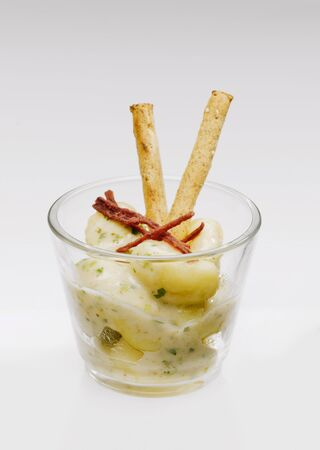 pretzel stick: Gnocchi with basil cream sauce in glass