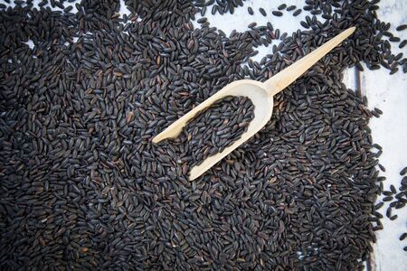 basmati rice: Organic basmati rice, black, small wooden shovel