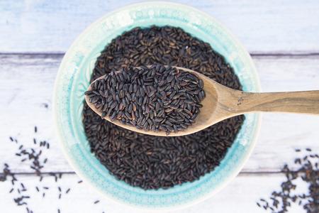 basmati rice: Organic basmati rice, black, in bowl, wooden spoon