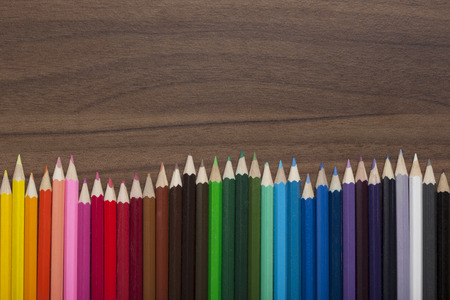 billow: Wave of colored pencils on wooden background