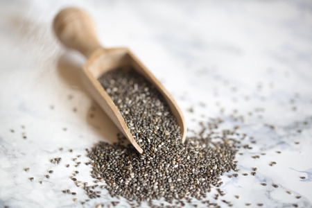 Chia seeds and wooden shovel