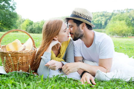 passionate kissing: Kissing couple on green meadow