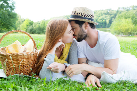 passionate kiss: Kissing couple on green meadow