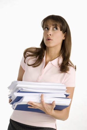 overstress: Young woman carrying files Stock Photo