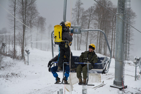 rehearse: SOCHI, RUSSIA - DECEMBER 12, 2013: Rescuers rehearse rescue on the ski lift. Mountain resort Rosa Khutor.