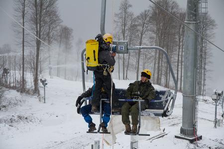 alpinism: SOCHI, RUSSIA - DECEMBER 12, 2013: Rescuers rehearse rescue on the ski lift. Mountain resort Rosa Khutor.