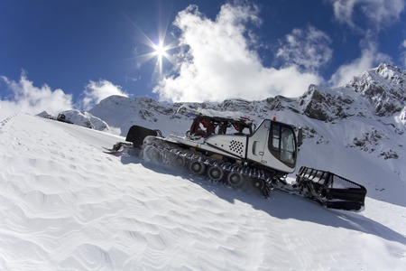snow grooming machine: Ratrak, grooming machine, special snow vehicle on ski piste Stock Photo