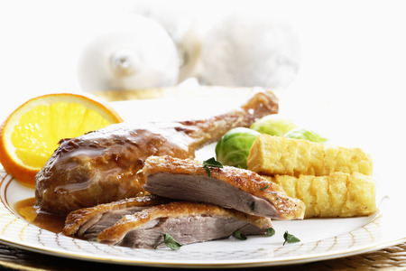 croquettes: Roast goose leg with brussel sprouts and potato croquettes Stock Photo