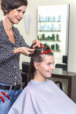 beautification: Young woman and female hairdresser