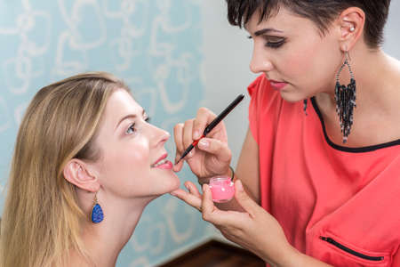 cosmetician: Young woman and cosmetician, make up