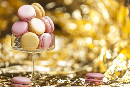 macarons: Macarons in glass, golden background