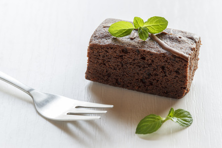 mint leaves: Brownie with mint leaves, fork