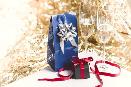 champain: Two presents and two glasses of champain