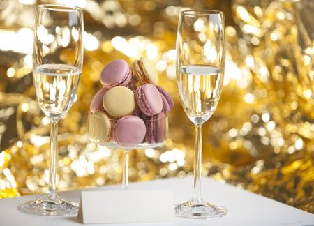 champain: Macarons in glass with champain glasses and place card