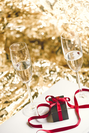 champain: two glasses of champain and a present
