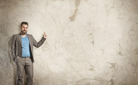 advertisment: Empty Grunge Wall, Business Man as Presenter Stock Photo