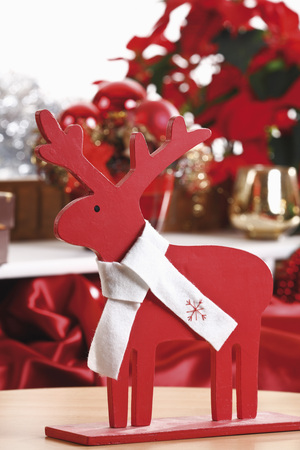 christmas elk: Christmas decoration, Wooden elk  figurine with white bow, close-up