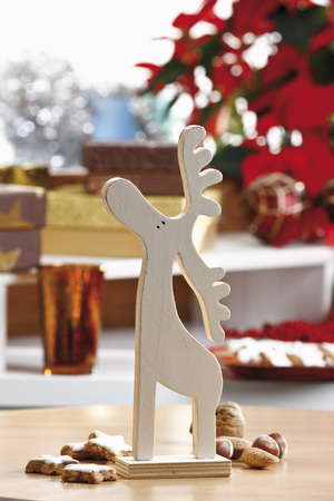 christmas elk: Christmas decoration, wooden elk figurine and cookies on table Stock Photo