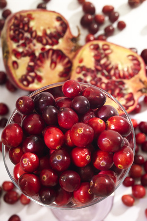 vaccinium macrocarpon: Pomegranate and cranberries in a glass