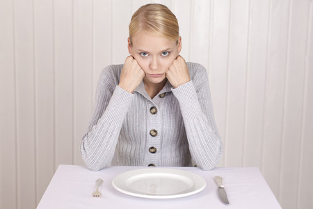 WEIGHT: Anorectic woman in front of empty plate