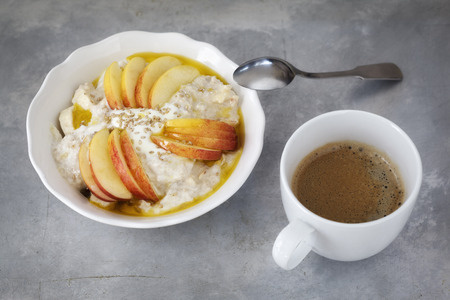 sesame seeds: Bowl with porridge, apples, banana, sesame seeds and coffee cup Stock Photo