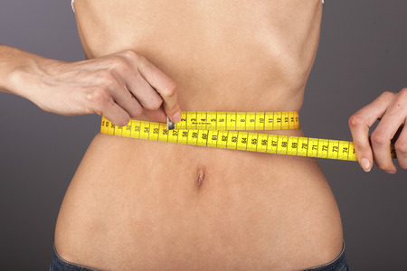 women body: Anorexic woman with tape-measure