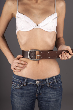 Anorexic woman with bell on belly Stock Photo - 39191497
