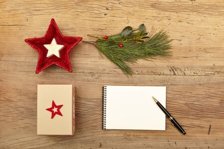 fir twig: Christmas present, notepad and fir twig on wood Stock Photo