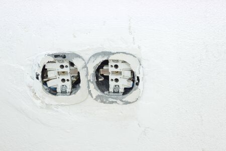 light socket: Interruptor de luz y enchufe en la pared Foto de archivo