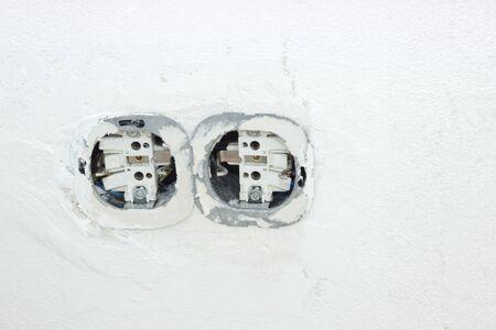 refurbishment: Light switch and plug socket on wall