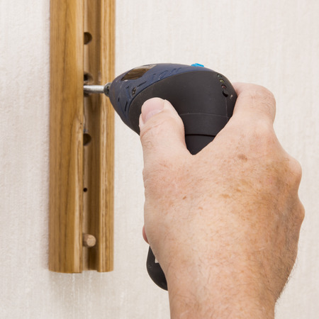 screwing: Hand and drill, screwing on a shelf ledge