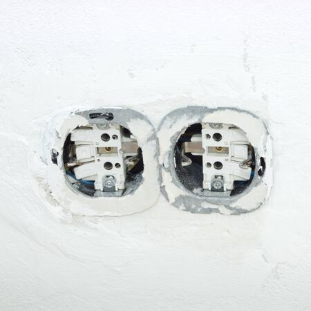 light switch: Light switch and plug socket on wall