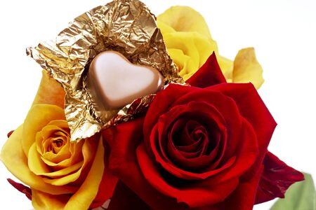 heartshaped: Yellow and red rose, Chocolate praline heart-shaped Stock Photo