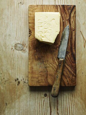 chopping board: Chopping board, butter and knife