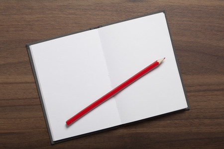 red pencil: Red pencil on notepad Stock Photo