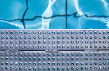 Swimming pool, stair, perforated plate Stock Photo