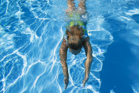 Swimming pool, woman swimming under water 스톡 콘텐츠