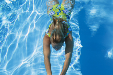 swimming pool woman: Swimming pool, woman swimming under water Stock Photo