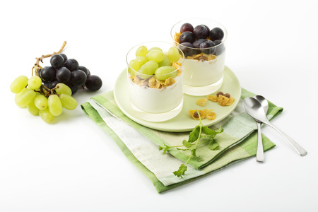 lowfat: Low-fat yoghurt with cornflakes and grapes in glasses