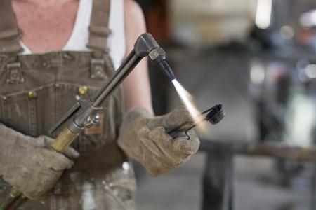 craftswoman: Female Welder in a Metal Shop