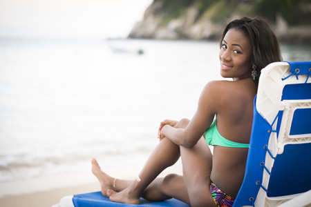 beach wear: Beautiful black woman wearing bikini on the beach, Mexico