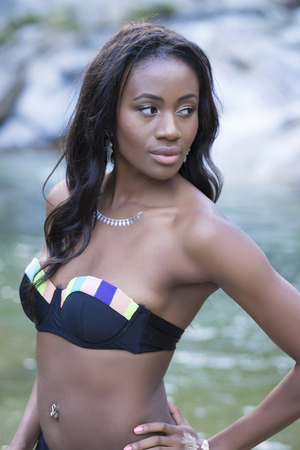 swimwear: Beautiful young black woman wearing bikini